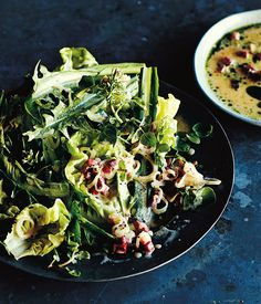 Butter lettuce and dandelion salad with hot bacon dressing