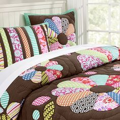 This bedspread is cute too because with all the different fabric prints it reminds me of a fun scrapbook page :)