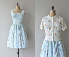 This would be mine if I wouldn't have to tape myself down to fit in the bodice. *sigh*  Diving Swallows dress and cardigan • vintage 1950s dress • cotton 50s dress