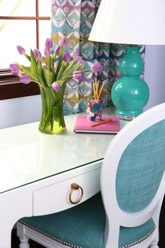 This small white desk is the ideal work space for a 10-year-old's bedroom. The inspiration started with the colors blue and purple, adding them in to look nice and girly without being too overwhelming.