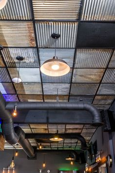 Create a nice industrial look with Barn Tin Tiles from CeilingConnex. Free shipping on orders over $400.  #ceiling #ceilingconnex #ceilingideas #barntintile #barntin #industrialdesign #loft #bardesign #dakotatin