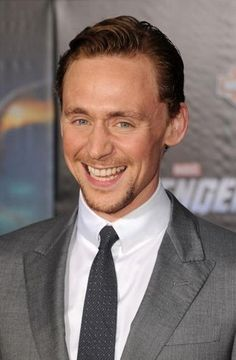Tom Hiddleston beats out co-stars Chris Hemsworth and Chris Evans to be this year's hottest actor.