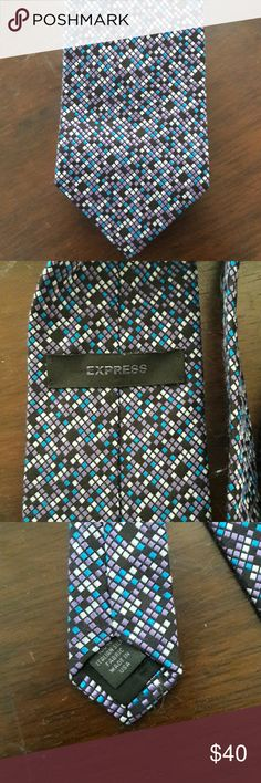 Express Necktie This awesome Express Necktie features purple, blue and black accents. It is 100 % Italian silk and made in USA. Express Accessories Ties