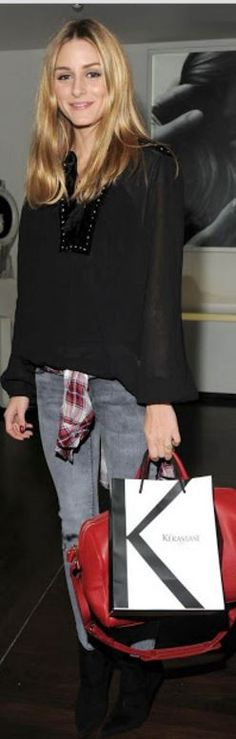 Who made Olivia Palermo's gray skinny jeans, black velvet tie top, and red handbag?