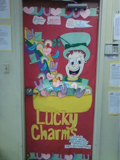 "Here is a cute St. Patrick's Day classroom door display titled ""Lucky Charms."""