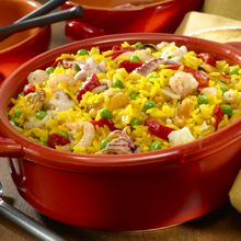 Easy Seafood and Rice Recipe!   Mix the yellow rice with a medley of seafood, bright peas and Spanish pimientos to make a special, one-skillet, seafood and rice dinner that you can have on the table in 35 minutes, flat!