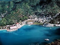 Pago Pago in American Samoa, if you look closely, somewhere in the mountains is my Grandparents house!