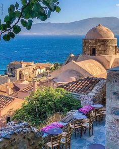 The medieval town of Monemvasia clings to the side of an island-like rock jutting out from Greece's southern Peloponnesian coast; Romantic Destinations, Travel Destinations, Monemvasia Greece, Travel Around The World, Around The Worlds, Greece Pictures, Places In Greece, Greece Islands, Best Cities