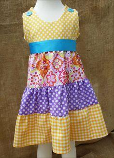 Girls Ruffled dress of Riley Blake and Robert Kaufman Polkadots Ginghams and Splendor Ceramic Prints.