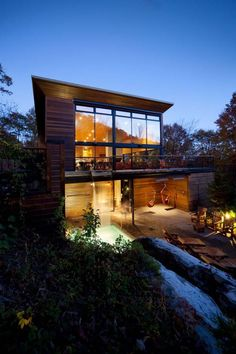 My dream...for my partner and me to read to our kids in those hammocks. Love the stained wood and dense forest surroundings, combined with the modern lines of the home.
