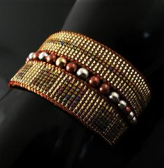 Golden strips of bead loomed Delicas with edgings of matte golden Kumihimo and a channel of metallic beads running through ... shine alert! Sold.