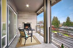 Bedroom balcony with outdoor fireplace