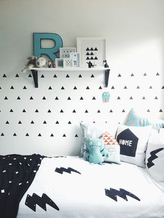 Black and white theme bedroom. With fun wall stickers. A space that will grown with them through the years.
