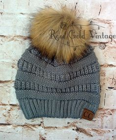 A little twist on the popular CC beanie hats - a faux fur pom pom on top! …