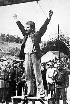 """Stjepan Filipović was a Croatian Partisan who was executed during World War II. He was captured on 24 February 1942 by Axis forces and subsequently hanged in Valjevo, occupied Yugoslavia, on 22 May 1942. As the rope was put around his neck, Filipović defiantly thrust his hands out and denounced the Germans and their Axis allies as murderers, shouting """"Death to fascism, freedom to the people!""""."""