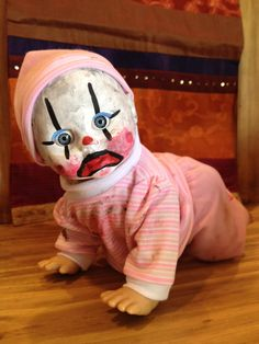 Great display doll for your Halloween party! This doll has been altered and distressed with acrylic paint. She measures about 12 inches. She also cries, laughs and crawls. Not a toy for children. Very creepy!    She comes wrapped in clear cellophane with a festive Halloween ribbon!