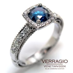 venetian-5004 engagement ring with a deep blue diamond.