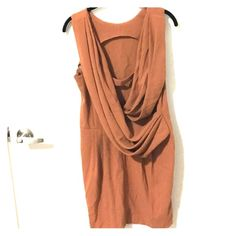Tan Asos dress with a Grecian back! ASOS Grecian back style dress in great condition!  The simple sheath shape  in the front makes it perfect for work, and the back makes it perfect for cocktail parties, date nights and special events! Open to offers :) ASOS Dresses Midi