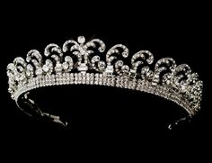 """Queen Elizabeth's Halo Tiara  This diamond and platinum tiara was made in the """"Halo"""" style, popular at the time to suit the softer hairstyle..."""
