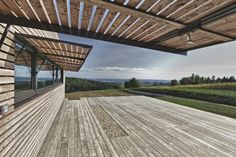 Huge operable finned awnings.  Project - Summer House in Southern Burgenland - by Judith Benzer Architektur