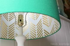 Stenciling a hidden pattern on a DIY lampshade using the Drifting Arrows Stencil http://www.cuttingedgestencils.com/drifting-arrows-stencil-paint-a-pillow-kit.html
