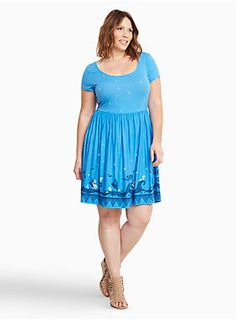 """We're going island-hopping with this skater dress! The Moana-inspired look features a cool blue slub knit that's modeled after the night's sky. The border print is fit for adventuring with Moana and Maui. The crisscrossing back lends strappy appeal to the easy look.<div><br></div><div><b>Model is 5'9.5"""", size 1<br></b><ul><li style=""""list-style-position: inside !important; list-style-type: disc !important"""">Size 1 measures 37"""" from shoulder</li><li style=""""list-style-position:..."""