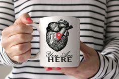 """You Are Here Mug Anatomical Heart Mug Coffee Mug Statement Mug Quote Mug Cute Mug Funny Mug Romantic Mug Holiday Gift for Him Gift for Her. You are Here! Great way to remind your special someone that you love them, each and every morning! Comes ready to gift in a wonderful gift box. All of our mugs are: - Dishwasher & microwave safe - Standard 3.15"""" x 3.15"""" white 11 oz mug - Design printed on both sides We take pride in our extremely well packaged shipments."""