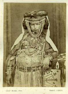 """Ouled Nail à Biskra, 1875 Auguste Maure was an orientalist photographer that lived in Biskra (Algeria) from 1855 to 1907. He created the """"Photographie Saharienne"""" studio in 1860 : the very first photography studio in south Algeria. Biskra is the queen of oases, a place where many artists (writers, painters and photographers) came in the 19th century to meet the particular climate, luminosity and landscapes of Sahara desert."""