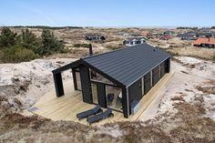 Lækkert feriehus med overdækket terrasse tæt på stranden