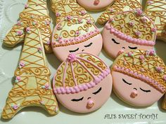 Ali's sweet tooth Eifel Tower cookies & baby faces | Cookie Connection