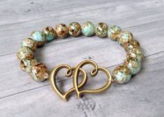 Mottled Glass Tones of Earth Brown, Sand Tan and Aqua Water Bead Stretch Bracelet with Antique Bronze Double Heart Charm