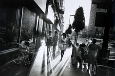 """Garry Winogrand: Hollywood Boulevard, 1969 """" A disabled man, bent over in a wheelchair, captures the attention of three women walking by and a boy seated on a bus stop bench. Garry Winogrand's photograph of Hollywood's once-glamorous Walk of Fame. Garry Winogrand, History Of Photography, Street Photography, Documentary Photography, Photography 2017, Photography Ideas, Vincent Van Gogh, Claude Monet, Era Virtual"""