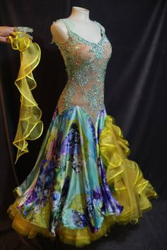 Unique mint green and yellow standard dress for sale. Full ruffled yellow skirt with floral layer overlay. Embellished bodice covered with stones. Open back with lace details on traps. Two separate gloves with attached floats. Size adult small/medium. $1800 USD or best offer.