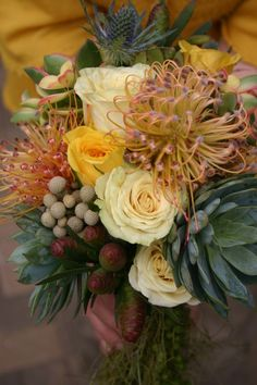 Protea / pincushion, Rosa, Echeveria, Eryngium, Leucadendron Like the look, but in pinks for this
