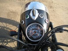 URAL headlight on a modern triumph. Very close to what I am considering. Very well done.