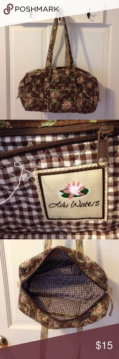 """Cotton floral barrel bag This little bag is full of organization 5 inside slip pockets and one zippered pocket . One small outside pocket. The brown background with light pink and dark pink flowers and green leaves is contrasted on the inside by brown and white gingham. Bag measures 12"""" wide x 6"""" high x 4 1/2"""" deep strap drop 10"""" with double zip entry . Cute boho chic bag!!! Bags Satchels"""