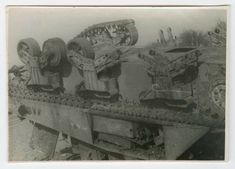 """Knocked out 12th Armored Division M4 Sherman named """"My Aching Back.""""  It has been flipped to scavenge suspension parts and hull sections harvested to make applique armor.  Gerard McCarthy collection."""