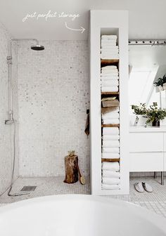 Idea for Towel storage. Like the accessibility next to shower and open shower with no door (please) tub coco + kelley - storage