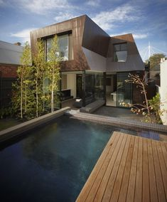BKK Architects have designed the Enclave House, located in Melbourne, Australia.