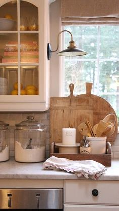 Farmhouse kitchen, white cabinets, marble counters, bread boards, kitchen ideas, decorating
