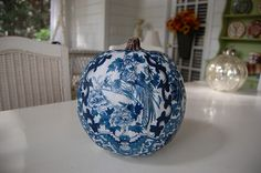 Decoupaged craft pumpkin...take your fabric fabric and make copies of it..use to cover your pumpkin...or anything!  Good tutorial here.