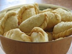 Ghughara / Gujiya - replace the ghee with oil to make it vegan. This is a traditional indian sweet with a flaky dough crust. The inside is usually filled with a sweet filling, that has a little spice to it.
