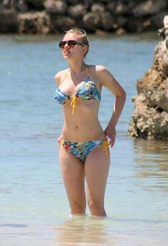 Scarlett Johansson in the kind of swimwear we are trying to keep you out of;)