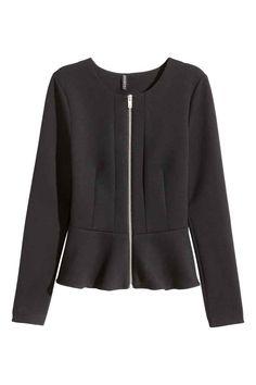 Casaco peplum: Casaco curto e cintado em jersey. Tem fecho éclair à frente, mangas compridas e folho évasé na base. Sem forro.