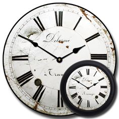 This distressed white clock is actually a photo of an old clock face from a grandfather clock. It was purchased in a flea market in Paris France. I believe Delorme (the words on the top of the clock) is the name of the manufacturer. It is a last name in France. It was originally a porcelain face that has been cracked and broken (which is what gives it its charm!!) You can choose the French inspired wall clock in seven sizes, 12 inch, 18 inch, 24 inches, 30 inches, 3 feet, 4 feet and 5 feet!!