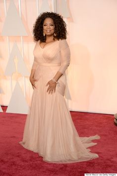 Oprah looks phenomenal in this buff rose Vera Wang gown