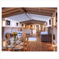 House boat. I would not have a glass table top but otherwise,beautiful.