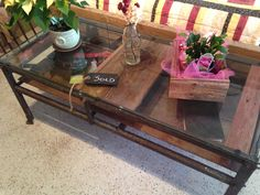 Refurbished iron stand - now the ultimate coffee table - reclaimed barn wood and a glass top - also a barn wood box - a vintage glass bottle wrapped with a spring is a cool vase as well! Reclaimed Barn Wood, Wood Boxes, Glass Bottles, House Ideas, Iron, Vase, Coffee, Cool Stuff, Spring