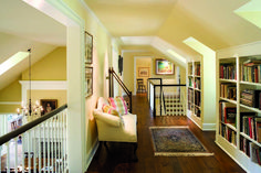 hallway bookshelves. Gorgeous design...Its like another room