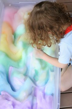 Rainbow Soap Foam Bubbles Sensory Play from Fun at Home with Kids - 1/4 cup water, 2 tbspn dish soap, watercolours and a hand mixer on high.
